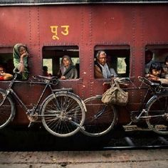 Bicycles hanging on the side of a train, West Bengal, India, Photographer: Steve McCurry Steve Mccurry, Smartphone Fotografie, Vivre A New York, World Press Photo, Composition Techniques, Afghan Girl, Digital Photography School, Photo Composition, Photography Composition
