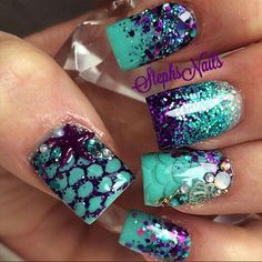 Paint the colors of the sea unto your nail with help from glitter nail art designs and add wonderful accents like starfish and scale details to complete the look. #HolidayNails