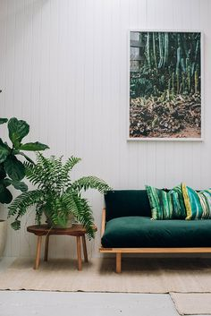 This emerald green sofa with the simple styling around it is so good!