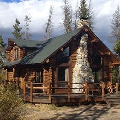 Perfect log home with stone chimney.