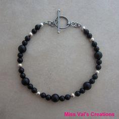 Black onyx sterling silver bracelet by missvalscreations. #blackonyx #etsy