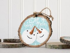 "Love Never Melts"" This is the original Love Never Melts painting from Linda Fehlen Gallery. This is a rustic, hand painted ornament. Each one is painted individually, and may vary sightly from the orn"