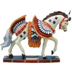 """Horse of a Different Color Bird Dancer Horse Figurine This Elegant Bird Dancer, Dressed In Feathered Plumes And Colorful Decorative Pieces, Symbolizes The Act Of Coming Together And Celebrating With Loved Ones. It Is Known As A Festival Horse, Since It Makes An Appearance Only On Special Occasions.      Individually Numbered     Breed Quarter Horse     Horse Stands 6.5"""" Tall     Made From Resin #IveysGifts #HorseFigurine"""
