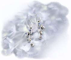 Bouquet of Rainbow Moonstone 925 Sterling Silver Dangle Earrings http://www.thechocolateopal.com/moonstone-dangle-earrings.html