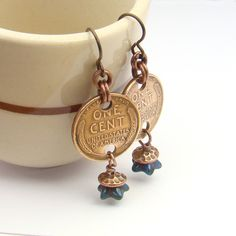 These fun coin earrings are made with US Wheat pennies from 1941. Use niobium earhooks, antiqued copper jump rings, and wire wrap a bead to dangle.