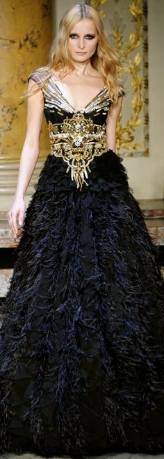 Zuhair Murad Haute Couture Spring Summer 2010 Collection black and gold gown that Isabel Baratheon would wear after successfully pushing her bastard half brother Edric Storm back to Harrenhal. Isabel bonded with the silver and black dragon Visenya who mated with Jon Targaryen's dragon Meerax, their thirteen children all became dragon riders as did Daemon Targaryen's wife Rhaena Velaryon and King Daeron's wife, Princess Alyssa Martell.