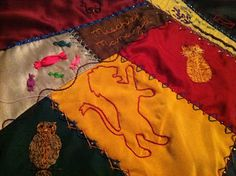 I'm still working on the Harry Potter quilt... really. The more I do, and the closer I get to finishing, the more needs to be done. It mak...