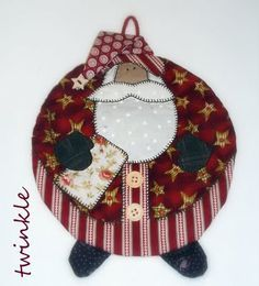 """pattern is from Art to Heart's """"Happy Holidays to You"""" booklet.  cute potholder, I like the way he looks more like he is wearing pajamas."""