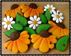 Decorated cookies featuring black-eyed Susans, daisies and leaves with cute little lady bugs - fall, autumn, spring, garden www.facebook.com/cookiesbycharity