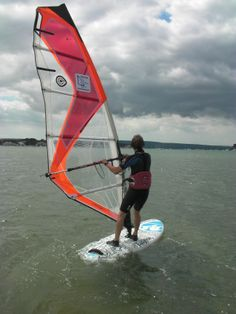 You could be forgiven for thinking this is somewhere in the Caribbean but no, it is Poole Harbour on a perfect day for learning how to use the harness in a moderate breeze.  This Poole Windsurfing student is doing just great with an instructor close at hand to make sure the harness technique is spot on. #poolewindsurfing #windsurfinglessons #pooleharbour
