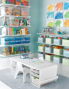 Love the idea of the table with the roll of paper going across the top!! Organized art room http://rstyle.me/n/d7p85nyg6