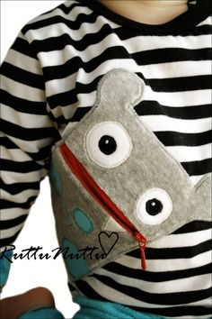 Inspiration - add a sideways zippered monster to a bag or a sweatshirt or - maybe a pillowcase!  No tutorial or pattern - just a couple of cute pics :D