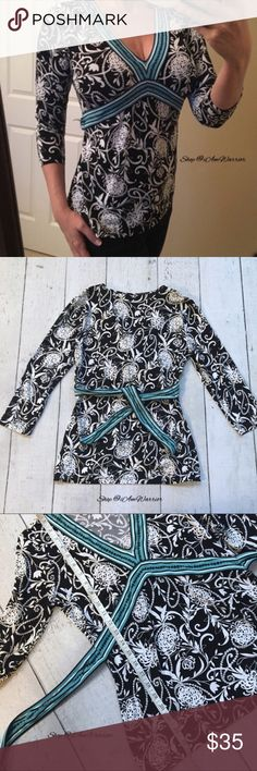 Loft black & white floral top w/turquoise tie belt Super cute Loft b&w floral print stretchy top with pretty turquoise tie back style, 3/4 sleeves and flattering v-neck. Excellent condition, smoke free home. See photos for measurements. Please read my bio regarding my closet policies prior to any inquiries. LOFT Tops