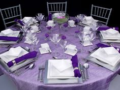 Love this table setting except for my wedding I would do a darker purple for the table cloth and then lighter purple for the napkins