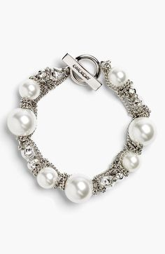 Givenchy Small Faux Pearl Bracelet available at #Nordstrom/ interesting, with the chain wrapped around the pearls and spacers.