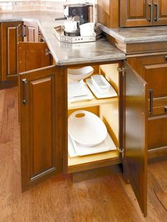 "The dual-door cabinet from Diamond Cabinets allows for easy access for dinnerware, serving bowls, and other kitchen items. Cabinet featured on DIY Network's, ""10 Clever Ways to Keep Your Kitchen Organized."""