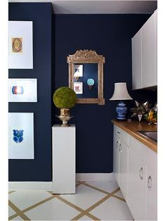 Would love to paint a bathroom or office navy with gold accents