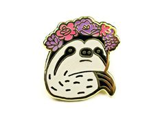 A unique hand illustrated sloth wearing a flower crown pin. This pin is perfect for your collar, jacket, bag, hat - anywhere you show off your flair collection.  • Cloisonne-style, hard enamel pin • Polished black graphite detailing • Military clutch backing • Measurements: 1.1 x 1  Please remember that colors vary slightly between monitors.       WEB: www.towne9.com FACEBOOK: www.facebook.com/towne9 INSTAGRAM: @hellotowne9 PINTEREST: www.pinterest.com/towne9