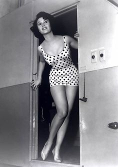In the 1950's, women wore one piece bathing suits like shown in the picture above. Two piece bathing suits were still not acceptable during this time period.