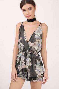 Feel pretty in this Floral Print Romper. Featuring a plunging neckline.