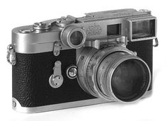 """Leica M3 + 5cm D/R Summicron. Probably my favorite usable 35mm rangefinder camera from several Leica cameras I've owned and used professionally. It shares my top place with the older screw-mount Leica IIIf RD/DA (Red dial, delayed-action) which, with a collapsible Elmar, would fit into my trousers pocket! However, my M3 Leica pictured here had the wonderful """"Dual Range"""" f/2 Summicron, with close-up goggles, a classic 1950s beauty which is now being used and enjoyed by a photographer in…"""