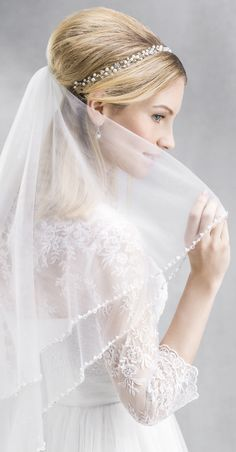 Wow! The beading on the edge of this veil is in perfect harmony with many of the trendy gowns on the market right now! (10106)