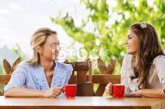 Two friends chatting with coffee Zdjęcie royalty-free