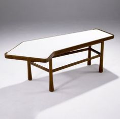 EDWARD WORMLEY / DUNBAR Coffee table with angled white laminate top on bleached mahogany base