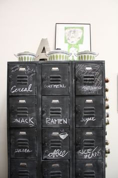 Chalkboard paint lockers for kitchen storage.