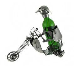 Chopper Motorcyclist Metal Sculpture Wine Bottle Display by Things2Die4. $42.99. Excellent Housewarming Gift. Unique Decor Piece. Wine/Liquor Bottles up to 3 in. Diameter. Metal Art. 12 1/2 in. Tall, 5 1/4 in. Wide, 14 1/2 in. Deep. This metal sculpture is a wine bottle display- it is a wonderful addition to your home decor, and makes a lovely housewarming gift for a friend! It measures 12 1/2 inches tall, 5 1/4 inches wide, 14 1/2 inches deep, and accommodates bottles...