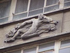 Deco relief carving on the front of Neville House, SW1.
