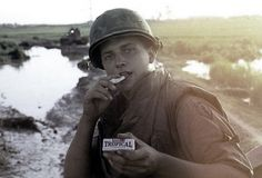 """¾ Cavalry soldier displays his """"Hershey's Tropical Chocolate"""", 1968"""