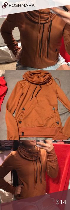 Rust colored cowl neck hoodie!! Unfortunately the tag was torn out but I believe it's a size small. I'm usually a small/medium and it's just a little snug on me! It's super cute!! And in great like new condition. Ask any questions you need and always make an offer stooker Tops Sweatshirts & Hoodies