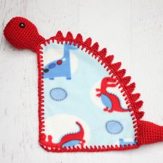 Crochet around fleece to make this cute dinosaur lovey blanket. Tutorial and FREE pattern!