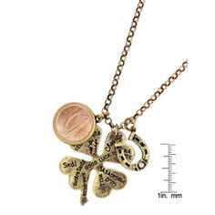 The Lucky Language Irish Coin Pendant shares good luck wishes across the globe with three special charms a clover, Irish penny and horseshoe. A burnished gold four leaf clover states good luck in several languages. #coinjewelry #coinpendants #luckycoins