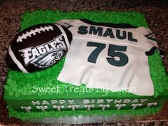 - Philadelphia Eagles cake.  Fondant personalized jersey.  Football is carved out of pound cake and fondant covered.