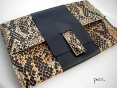 Handmade leather clutchBlack and animal print leather by Penhand, €35.00