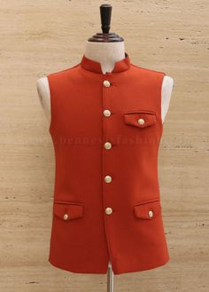 Get yourself adorned with this stunning waistcoat in orange color made from knitted fabric. It is designed with a mandarin collar, attractive buttons and unique flapped pocket style on the chest and waist. Wedding Dresses Men Indian, Groom Wedding Dress, Wedding Suits, Mens Fashion Suits, Mens Suits, Marriage Suits, Tan Bomber Jacket, Indian Groom Wear, Men's Waistcoat