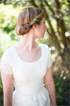 wedding hair styles #updo #classichair#weddingchicks http://www.weddingchicks.com/2013/12/19/festive-floral-wedding/