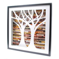 """Tree Shadowbox Symmetrical (by Amy Gibson) - intricately hand-cut tree against an autumn-colored collage of discarded pages. Shadowbox is 20.5"""" x 20.5"""", frame is .75"""" thick and 1.75"""" deep."""