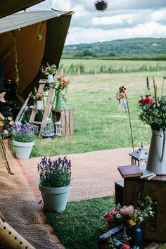 Bohemian Outdoor Tipi Wedding Flowers Ladder Jugs http://www.sarahjanesphotography.co.uk/