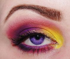 vibrant purple and yellow eye look with glitter liner