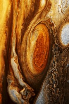 The Great Red Spot of Jupiter. Actually a storm that's been raging for over 300 years, it's three times the size of the entire Earth.