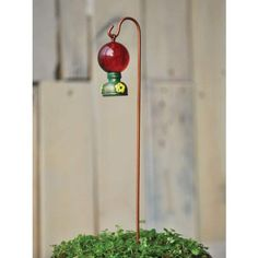 "Fiddlehead Fairy - Hummingbird Feeder with Shepherds Hook 8.5"" H Fiddlehead Fairy,http://www.amazon.com/dp/B00CXX50Y8/ref=cm_sw_r_pi_dp_gn02sb0EJ21833CV"