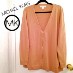 "Michael Kors Zippered Cardigan Michael Kors camel or tan colored zippered cardigan in size 2X or 18/20. Approx 30"" long. Large gold zipper with MK logo. Some pilling under arms from normal wear. (Photo 3 shows underarm area pilling, pills can be plucked or shaved off, if you want.) In very good condition. I've worn to work, date night, family dinner, you name it. Quality, timeless sweater. #plussize Michael Kors Sweaters Cardigans"