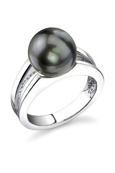 Tahitian pearl ring. Bill bought me a couple of tahitian pearls for our 25th in Hawaii. I've only had one set into a necklace. This might be good for the other one.