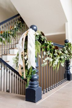 Staircase bannister Christmas decorations. Farmhouse garland that is elegant and simple.