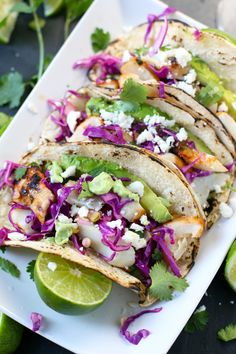 Easy and Healthy Grilled Fish Tacos made with halibut, Mahi Mahi, or cod, are full of great flavor! Perfect for weeknight dinners or Cinco de Mayo parties. #fishtacos #healthy #tacos #grilledfish #cincodemayo