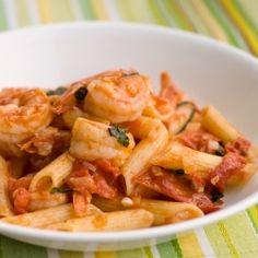 A wonderful, light summer pasta dish: shrimp and fresh tomatoes with white wine, garlic and basil.