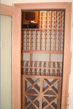 OK, so mine isn't quite this fancy, but now I have a wine closet instead of a coat closet, with racking!
